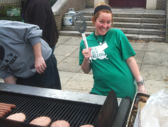 Brooke Jones cooks burgers for visitors to the Mosaic Church block party on Canal Street in New Orleans before the Krewe of Endymion Parade, Saturday, Feb. 9 2013.