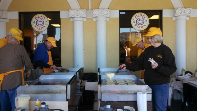 Disaster relief workers make pancakes for college students.