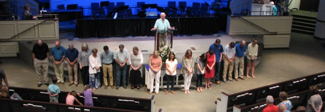 Dale Oden prays for the 2015 medical mission team.